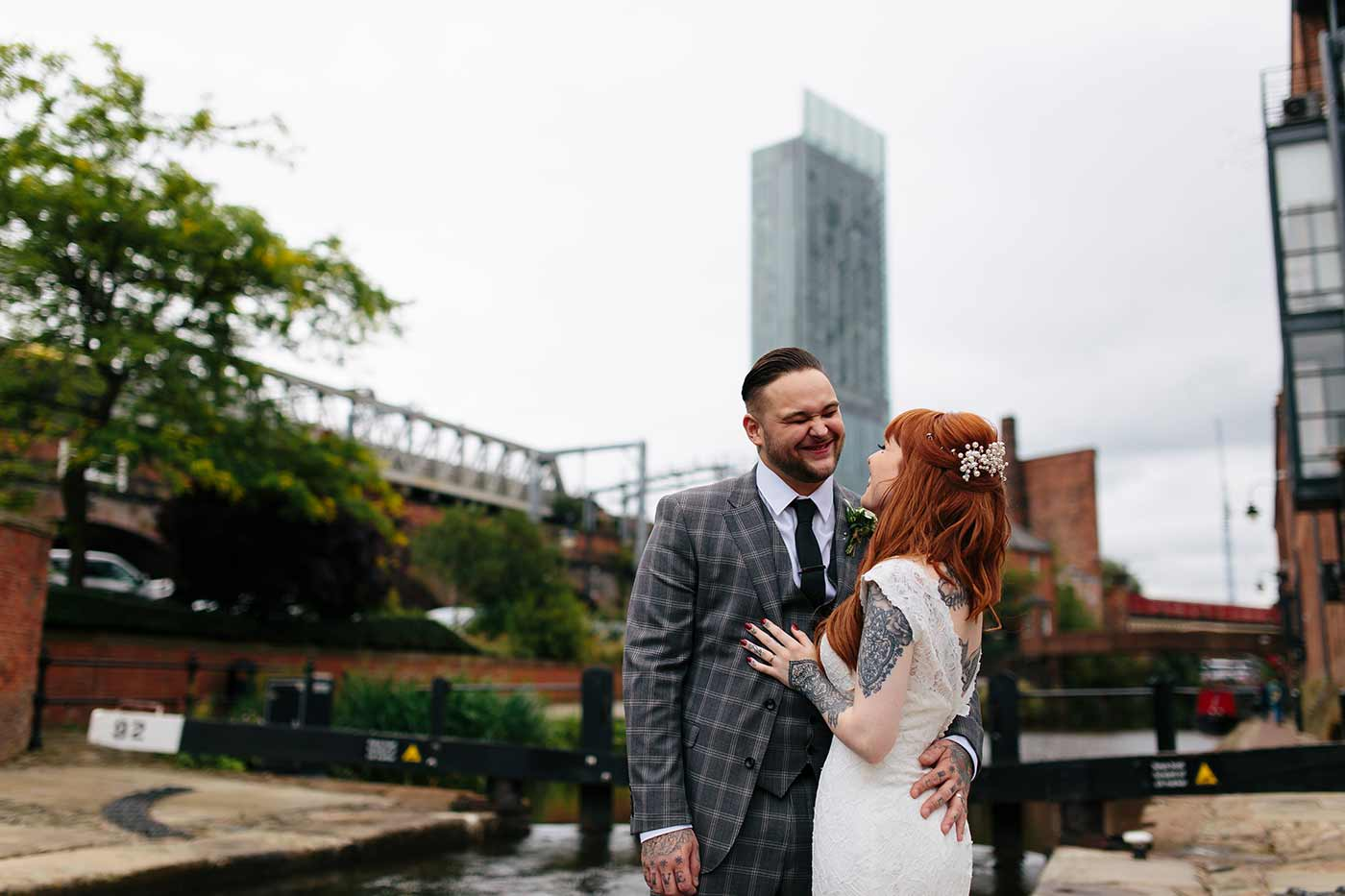 Alternative couples portrait with the hilton hotel manchester in the background