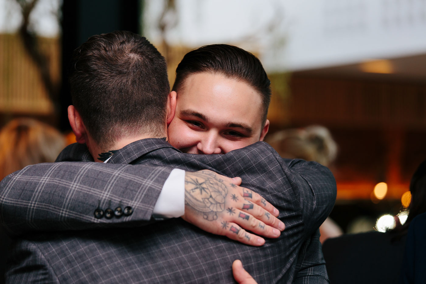 james giving a big hug to a wedding guest arriving