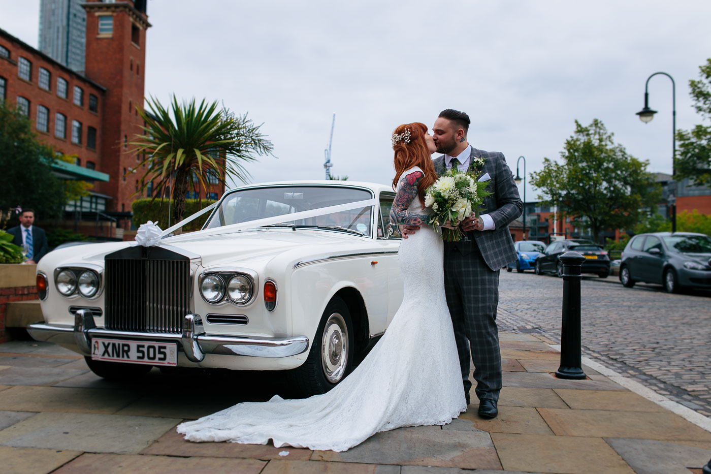 bride and groom with the vintage wedding car