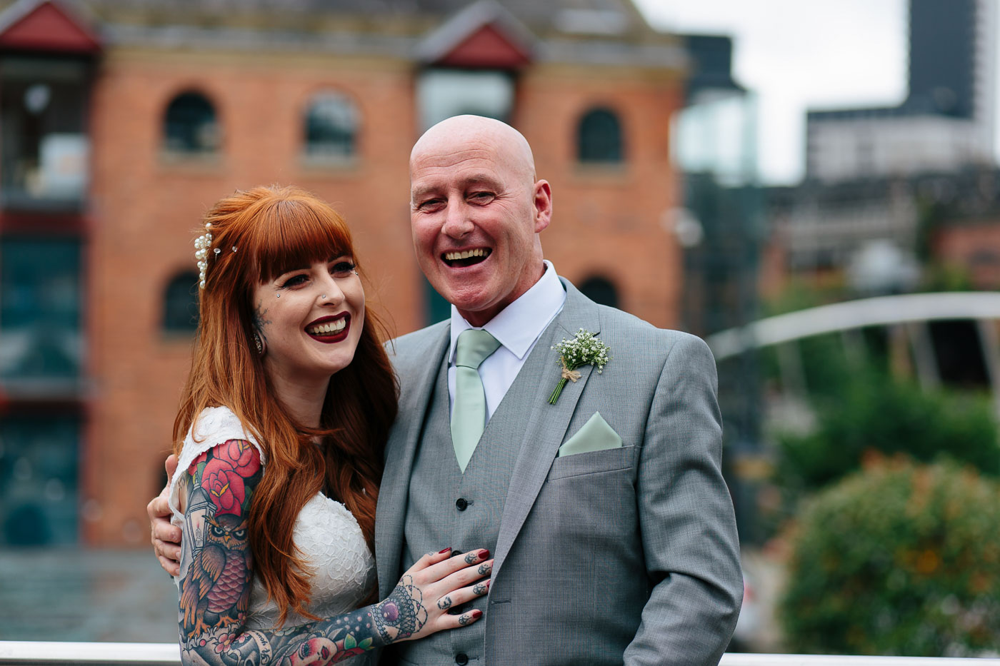 Emma with her dad on the balcony at castlefield rooms