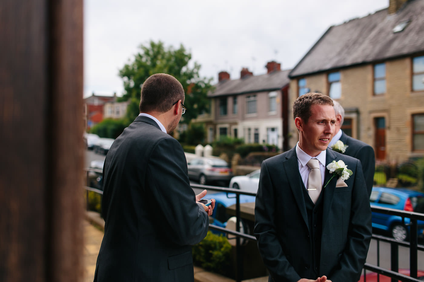 groom waiting nervously outside church