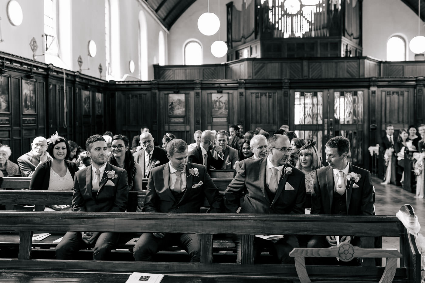 groomsmen waiting at the front of the church