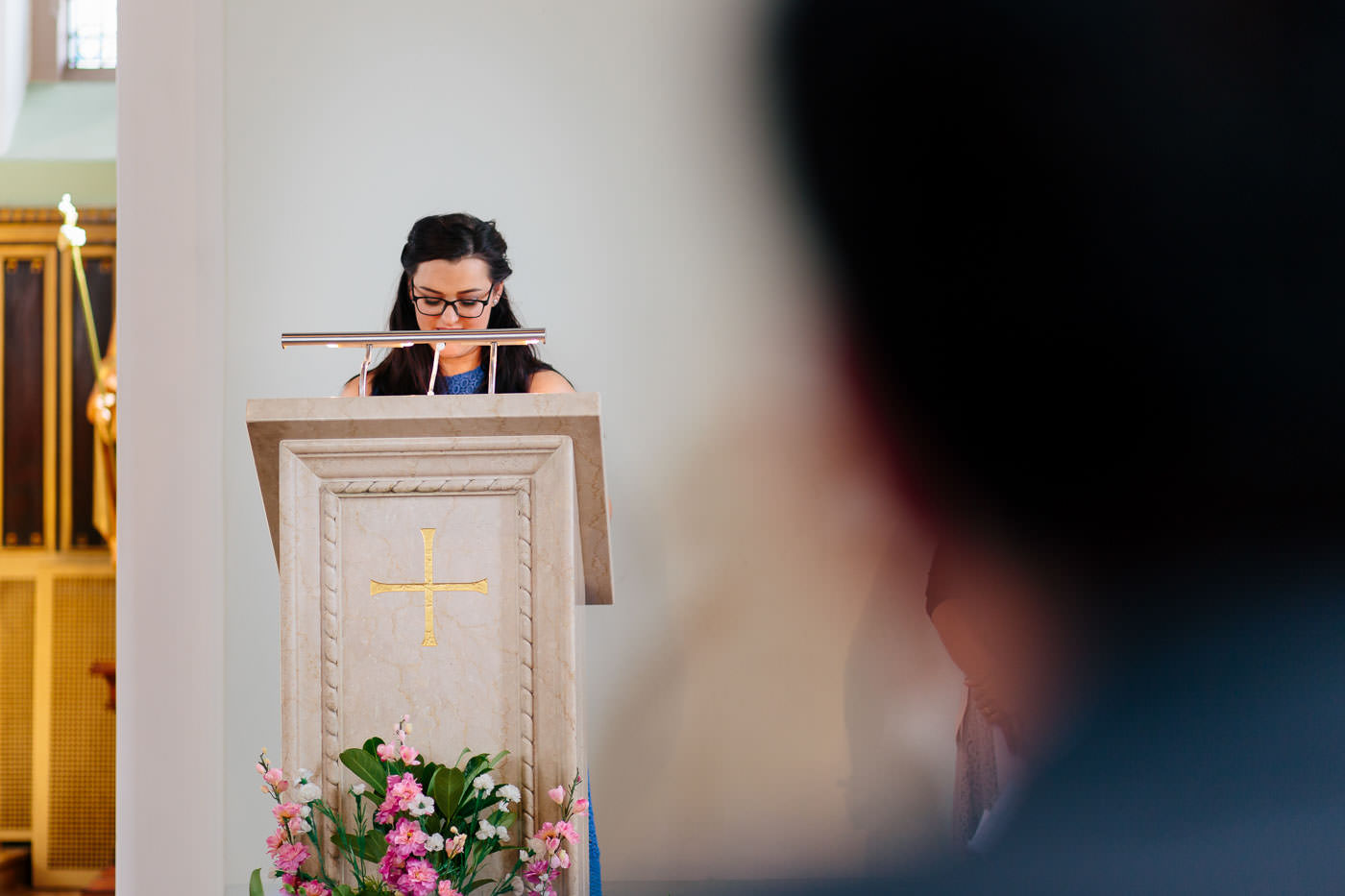 wedding guest giving a reading in church