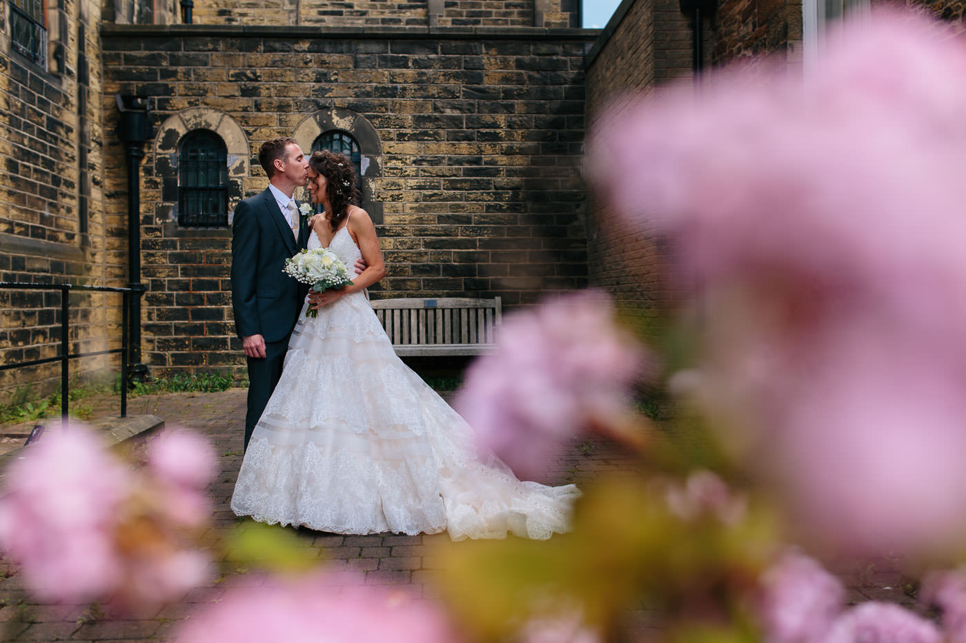 bride and groom portrait outside St Anne's church