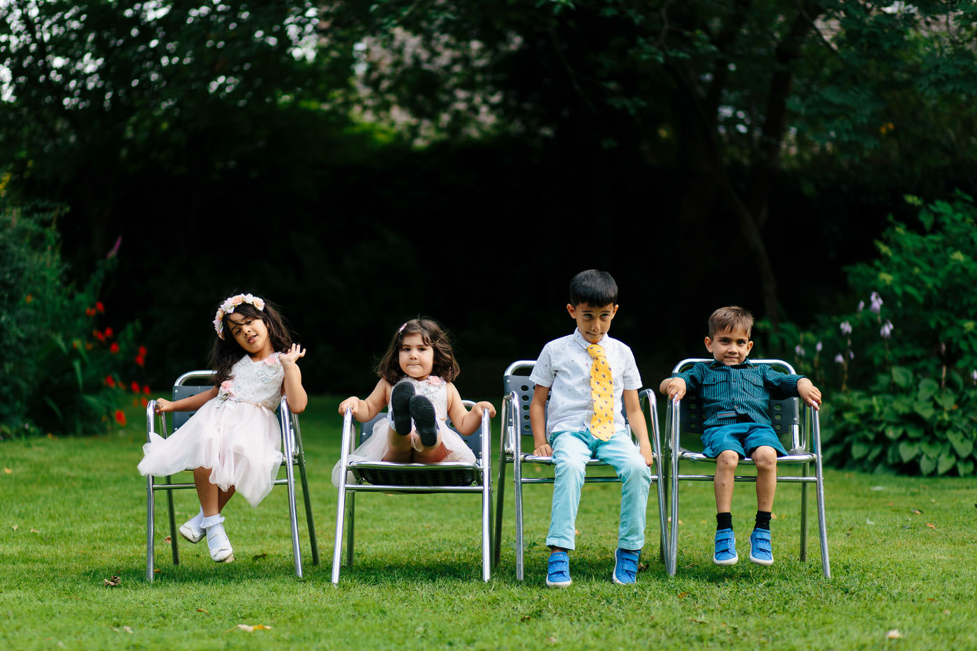 kids sitting in the lovely gardens of sparth house hotel