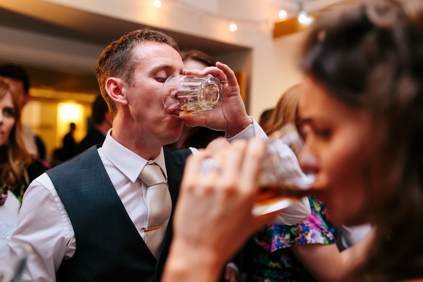 bride and groom drinking jagerbombs