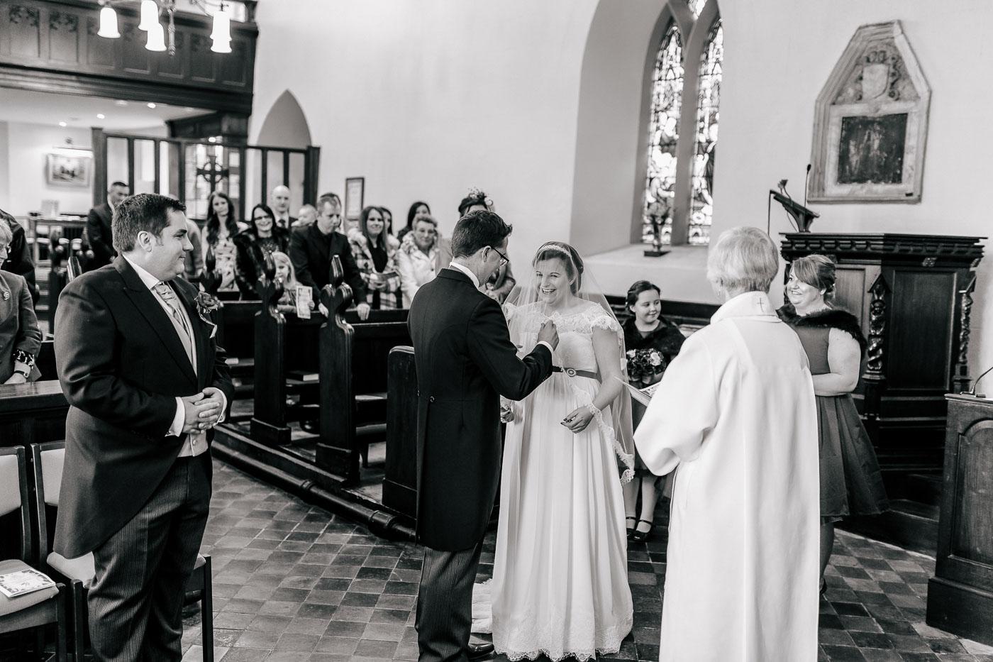 groom lifting the veil