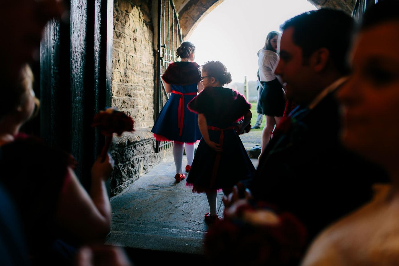 flower girls leaving church in marvel themed dresses