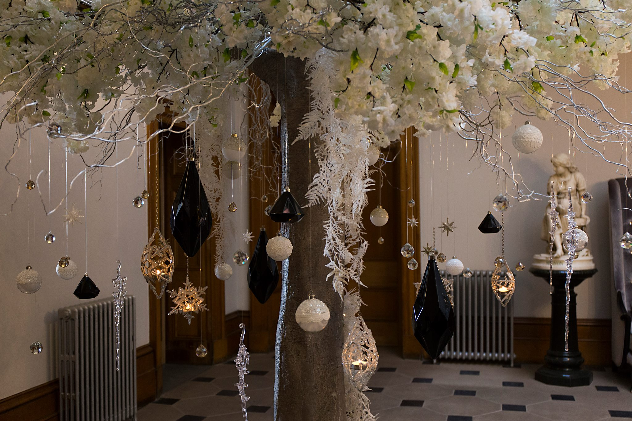 Close up of christmas baubles hanging from the tree in the entrance hall