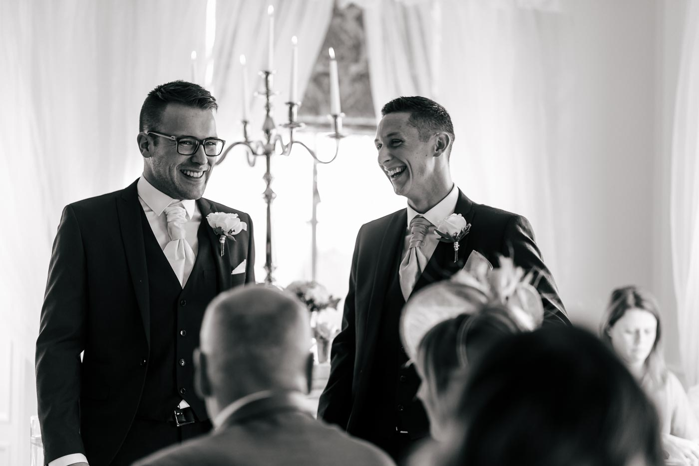 groomsman and groom laughing before the ceremony