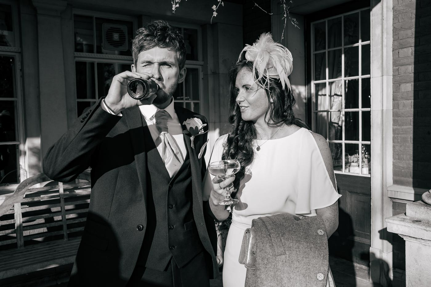 wedding guest drinking bottle of beer