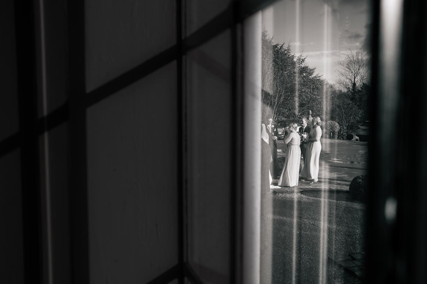 wedding guests taken through the window