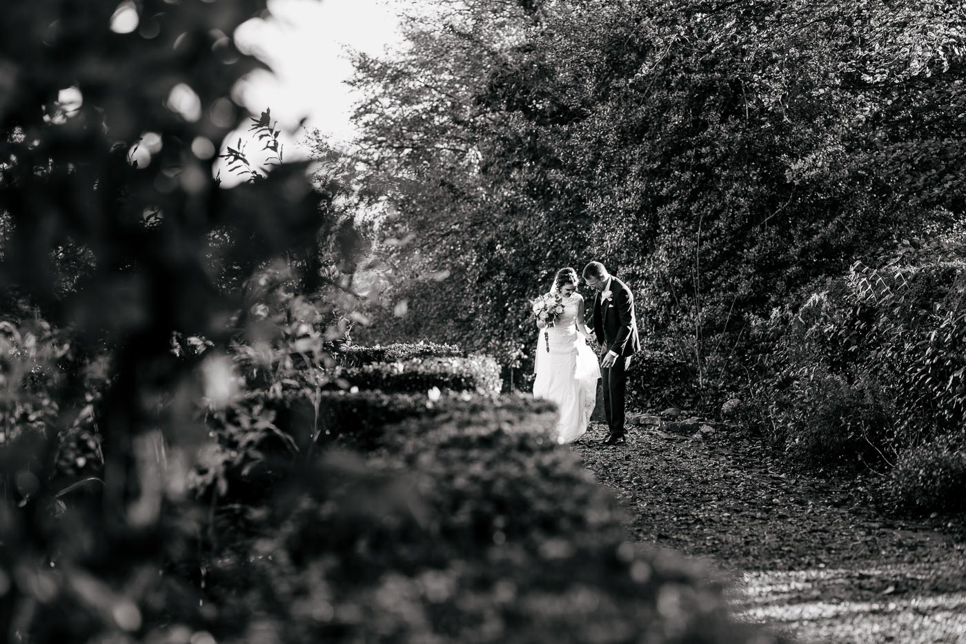 documentary wedding photography bride and groom walking in the gardens