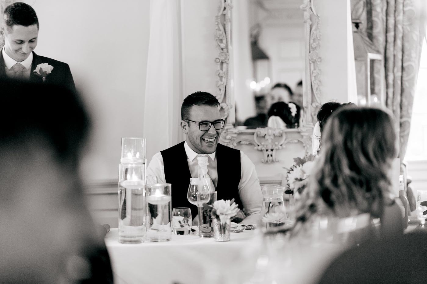groom laughing at best mans speech