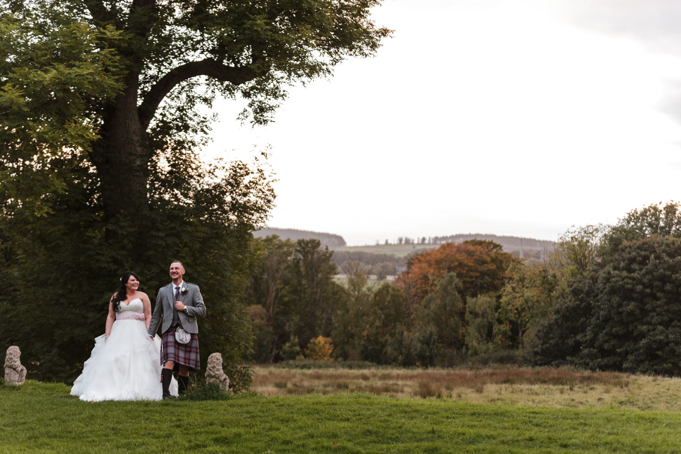 wedding couple photograph outside with the winter sun shining through the trees, ardoe house wedding couple