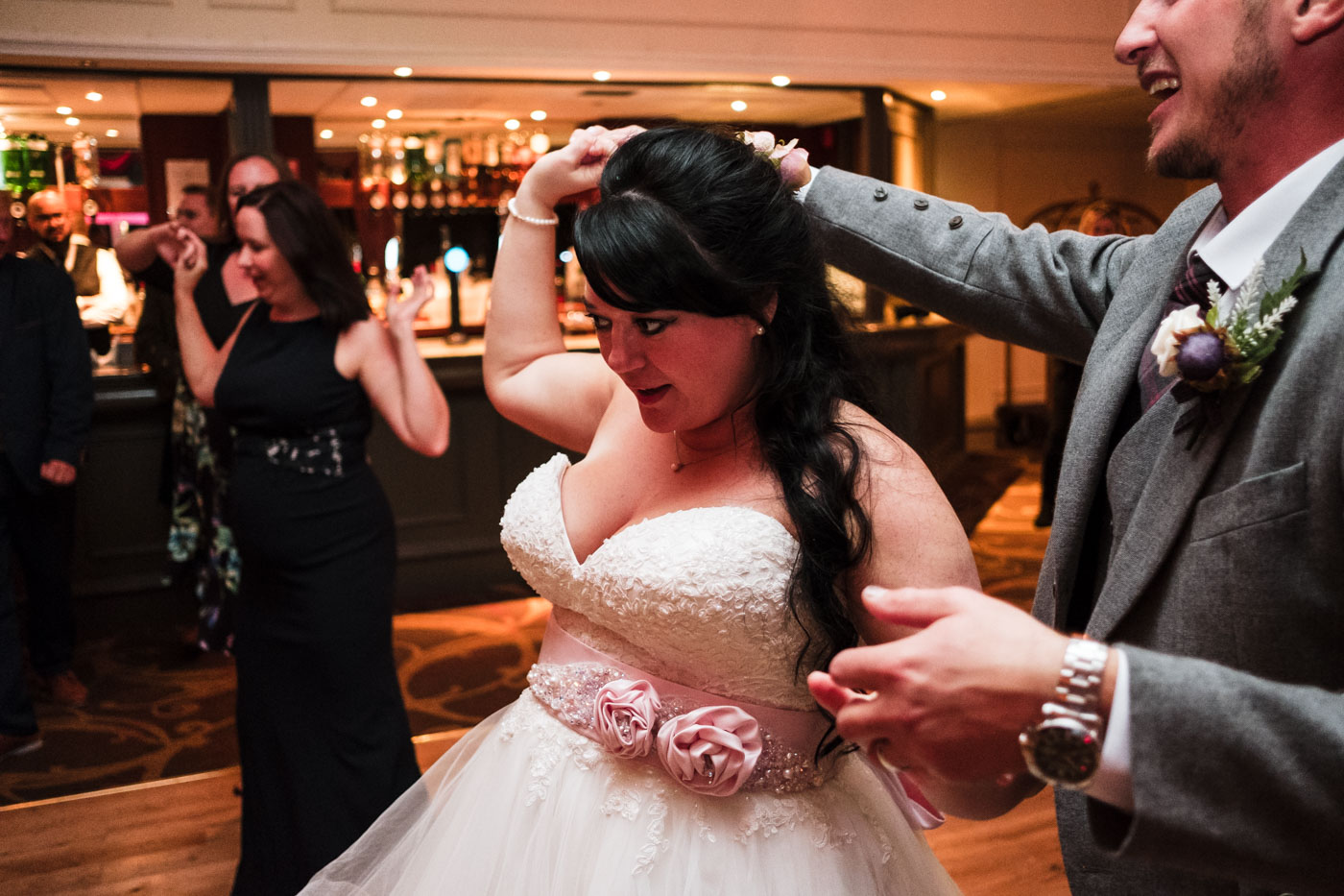 bride dancing with her new husband, documentary wedding photographer