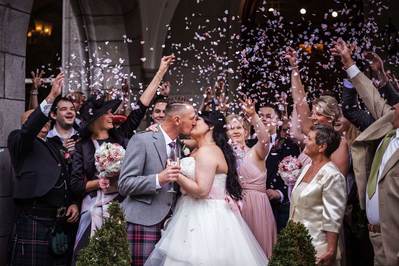 confetti photograph at the front of ardoe house hotel in aberdeen