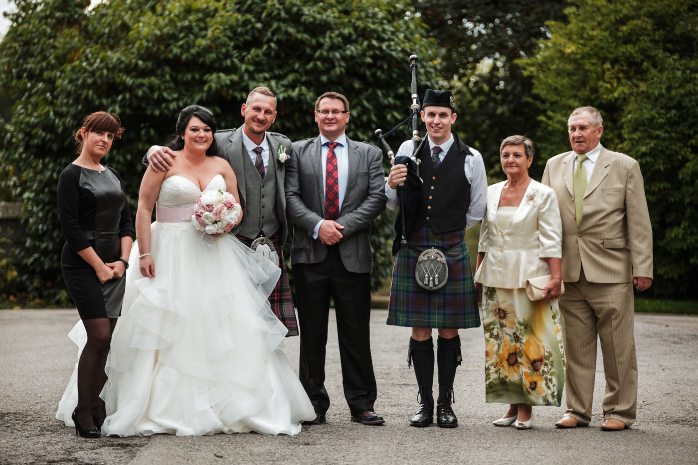 family group shot with bag pipe player