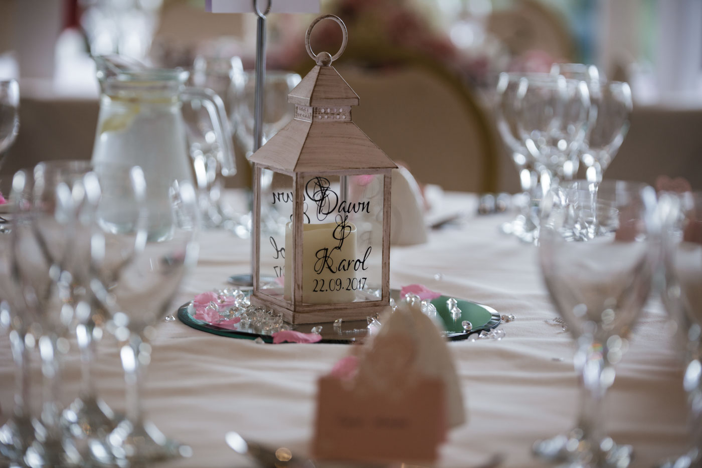 table details with personalised candle lanterns
