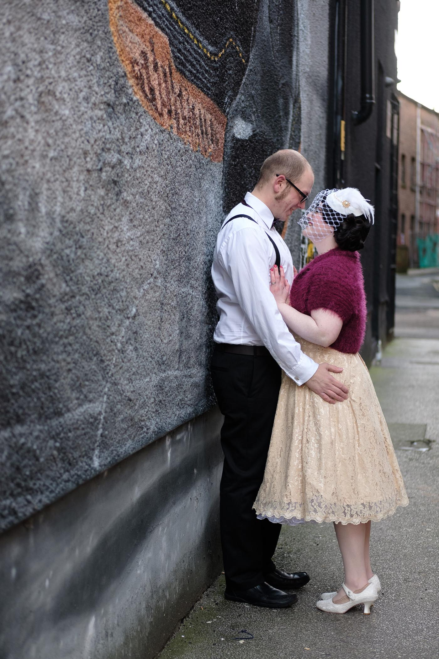 couple shoot with bride wearing a vintage 1950 wedding dress