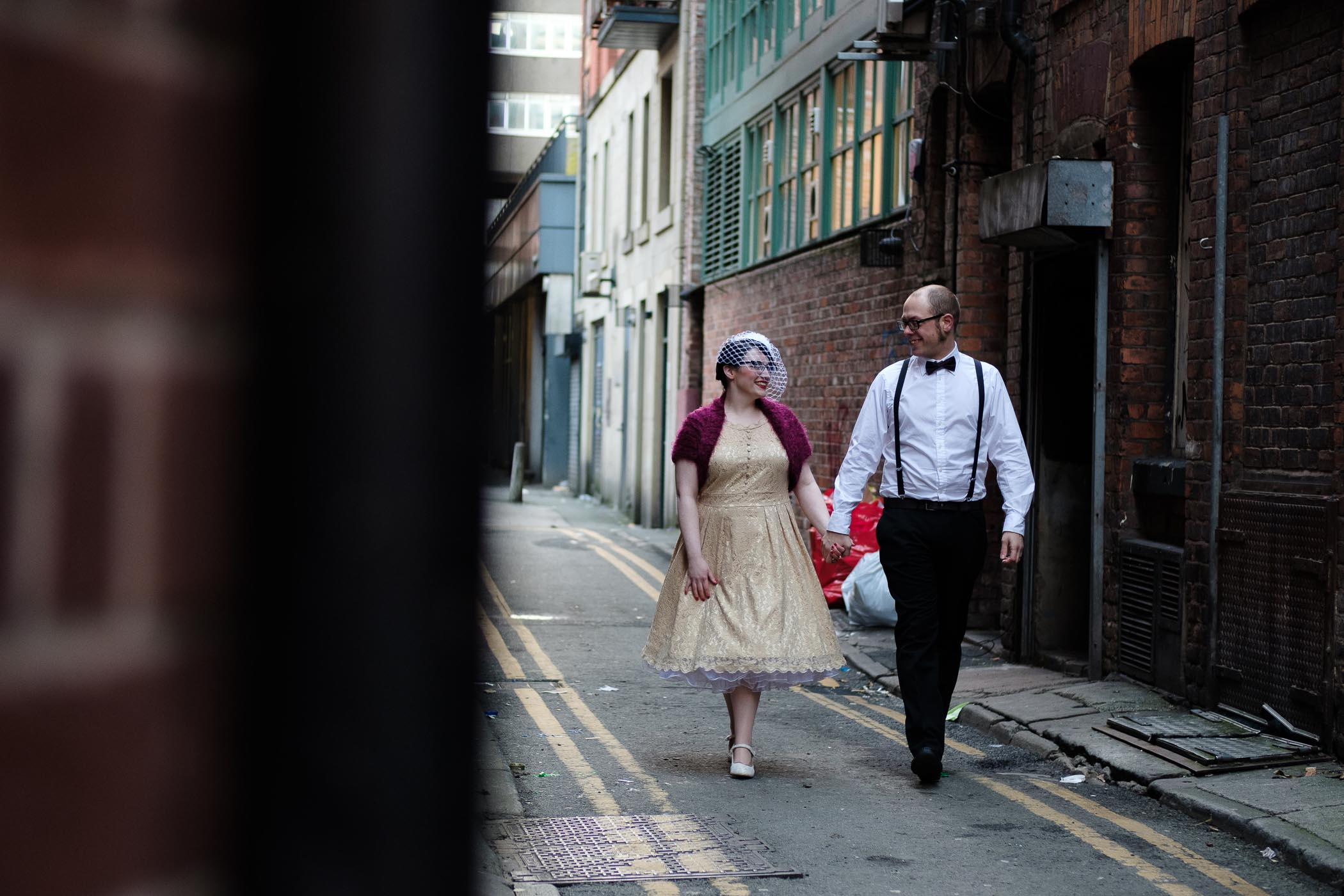 Gemma & Mike walking through side street in Manchester