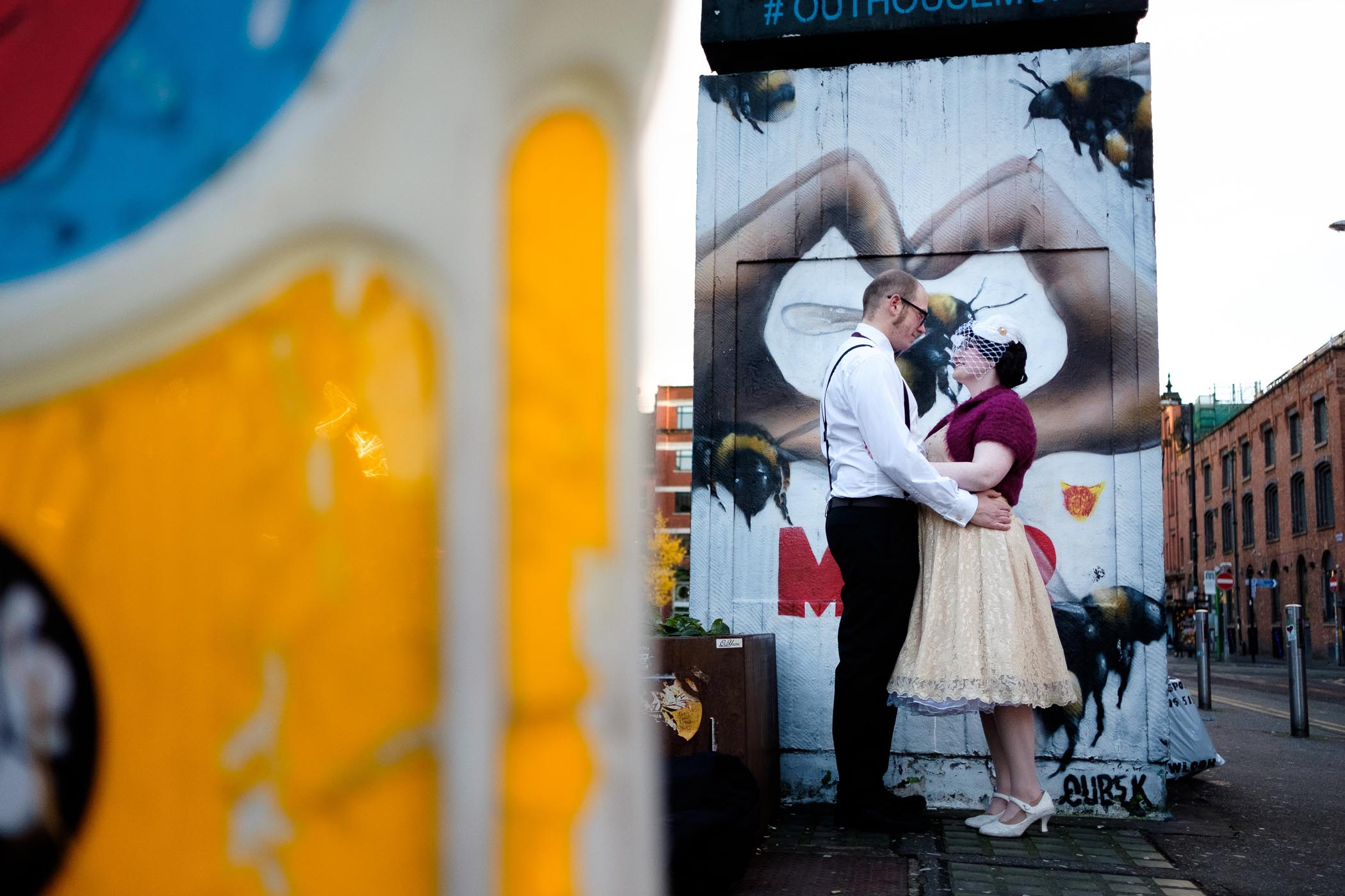 manchester couple shot with bee graffiti in background
