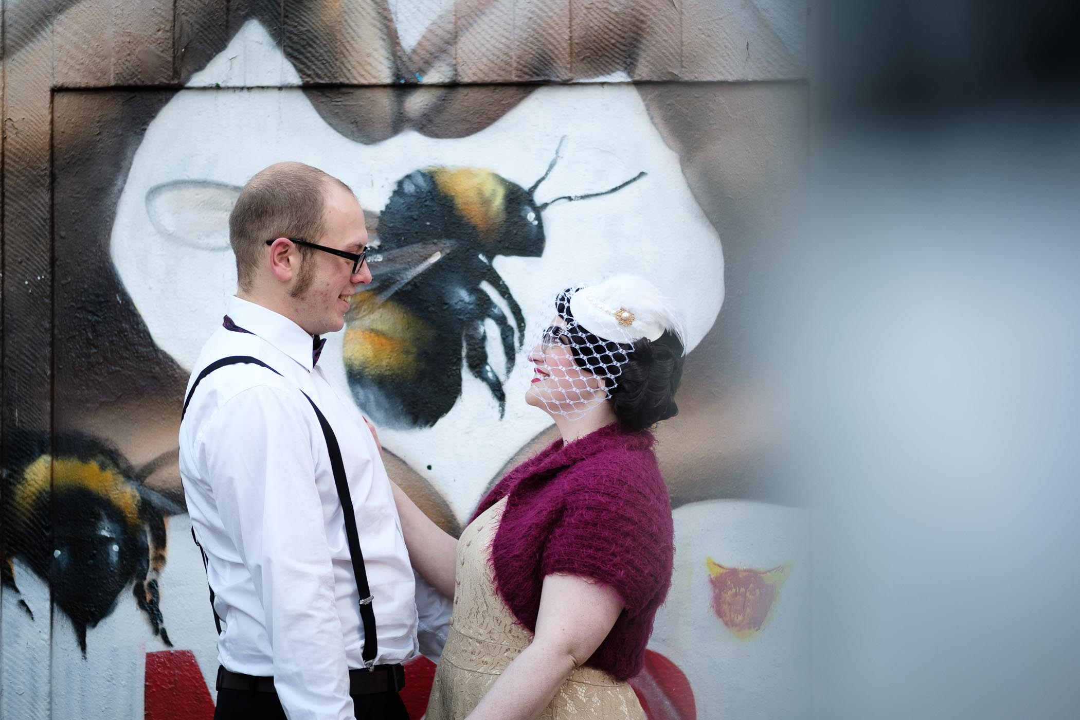 manchester bee wall with couple smiling