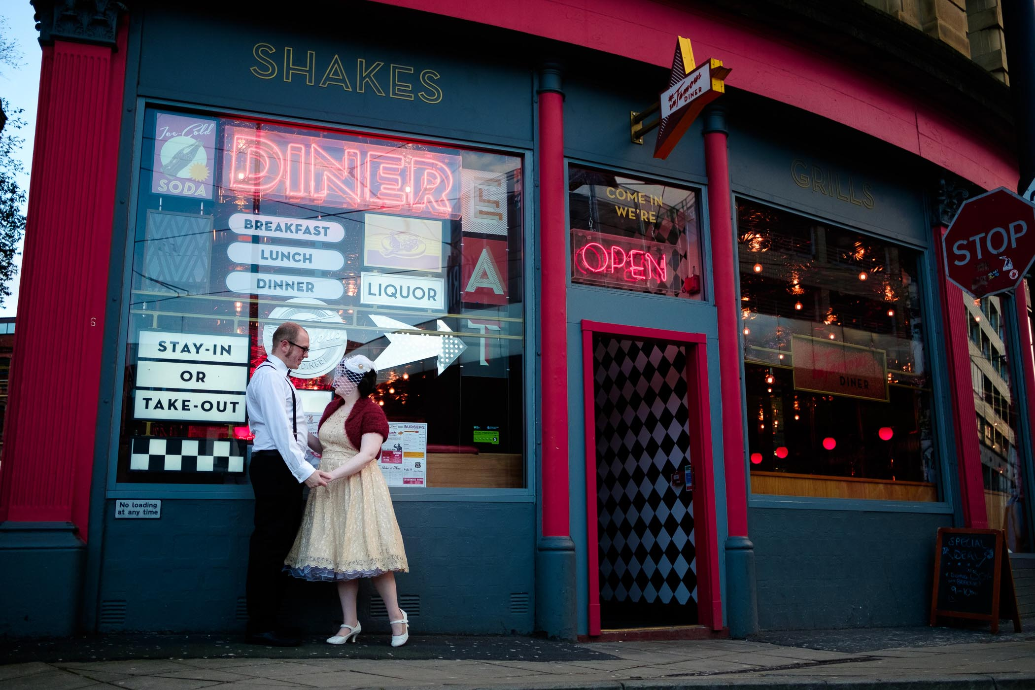 vintage couple shoot outside american diner in manchester