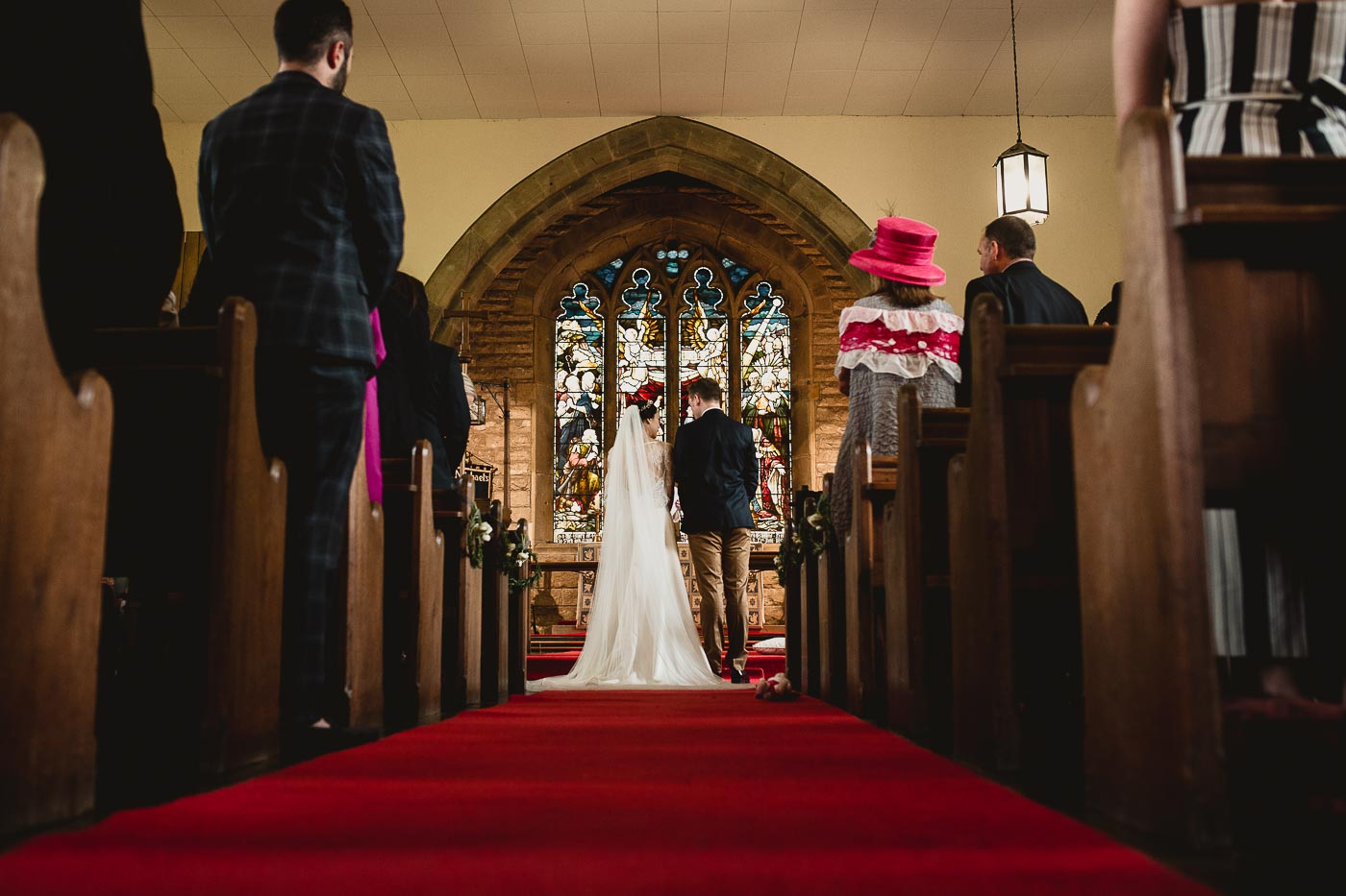 Bride and groom at the front of church, Handmade weddings