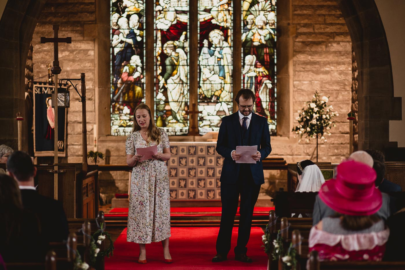 Wedding guests giving readings at the front of church, Ribble valley wedding