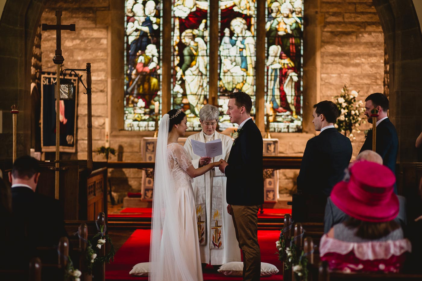 Bride and groom holding hands for wedding vows in church, Relaxed church wedding