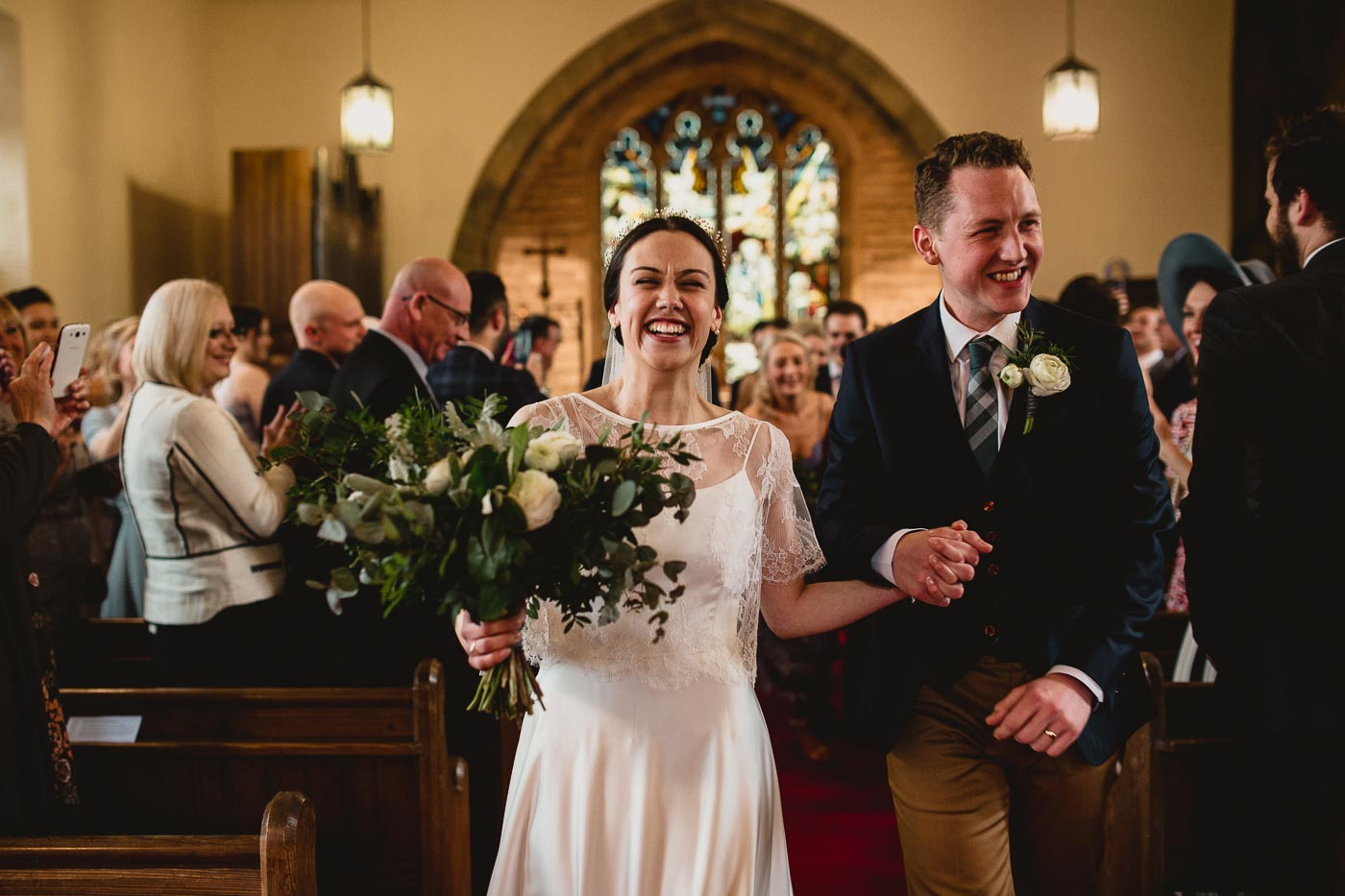 Lovely smiles as couple walk out of church, Lancashire relaxed wedding