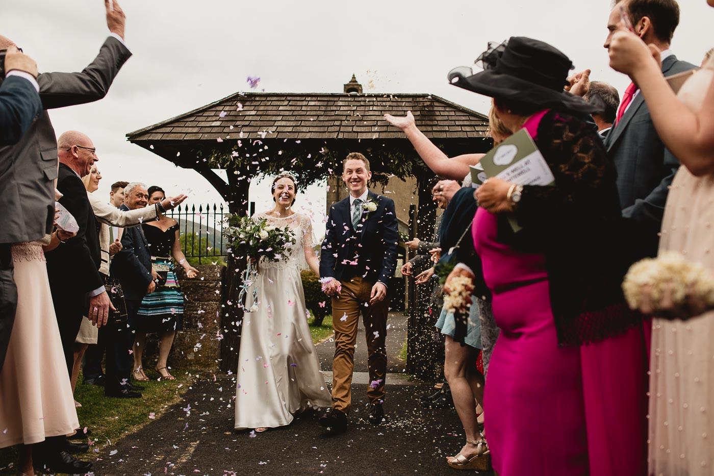 Confetti thrown as couple walk out of church grounds, Wedding confetti shot