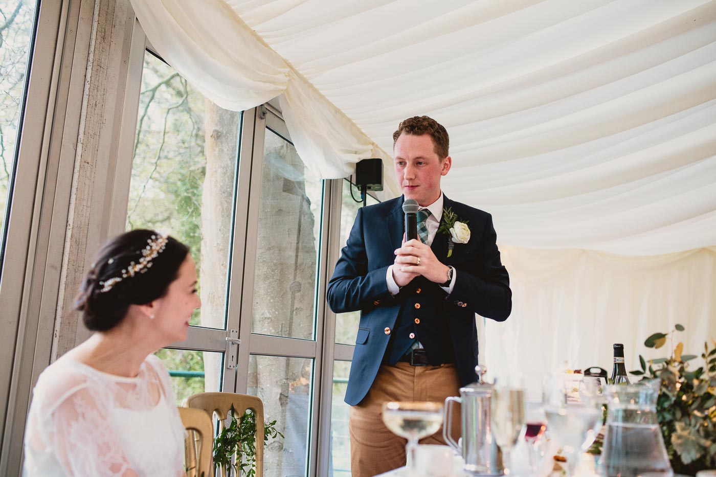 Bride looking at the groom whilst he gives speech with details about how they met, Lancashire Pub Wedding