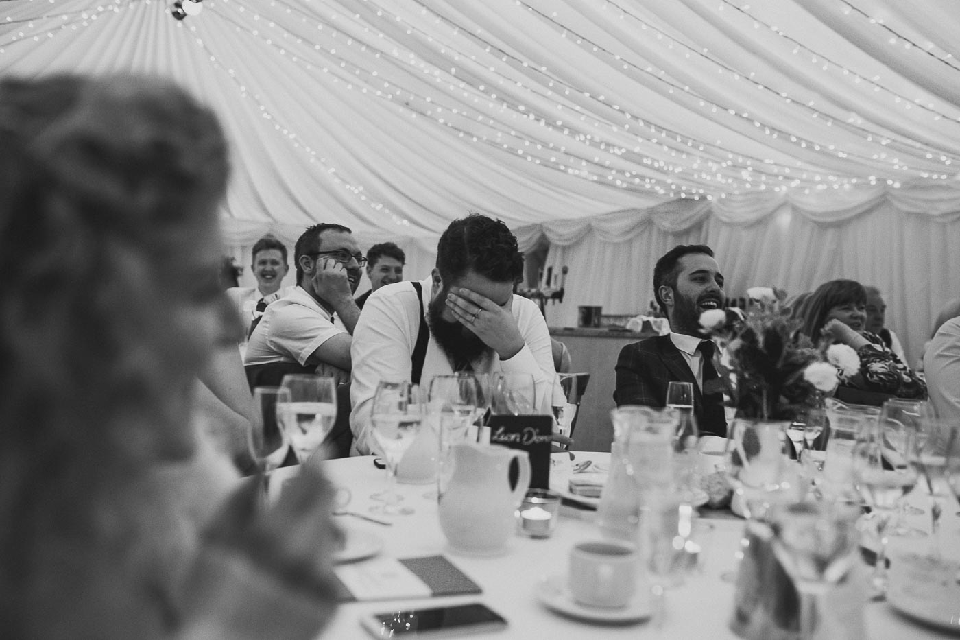Wedding guests in marquee, Candid moments wedding photographer