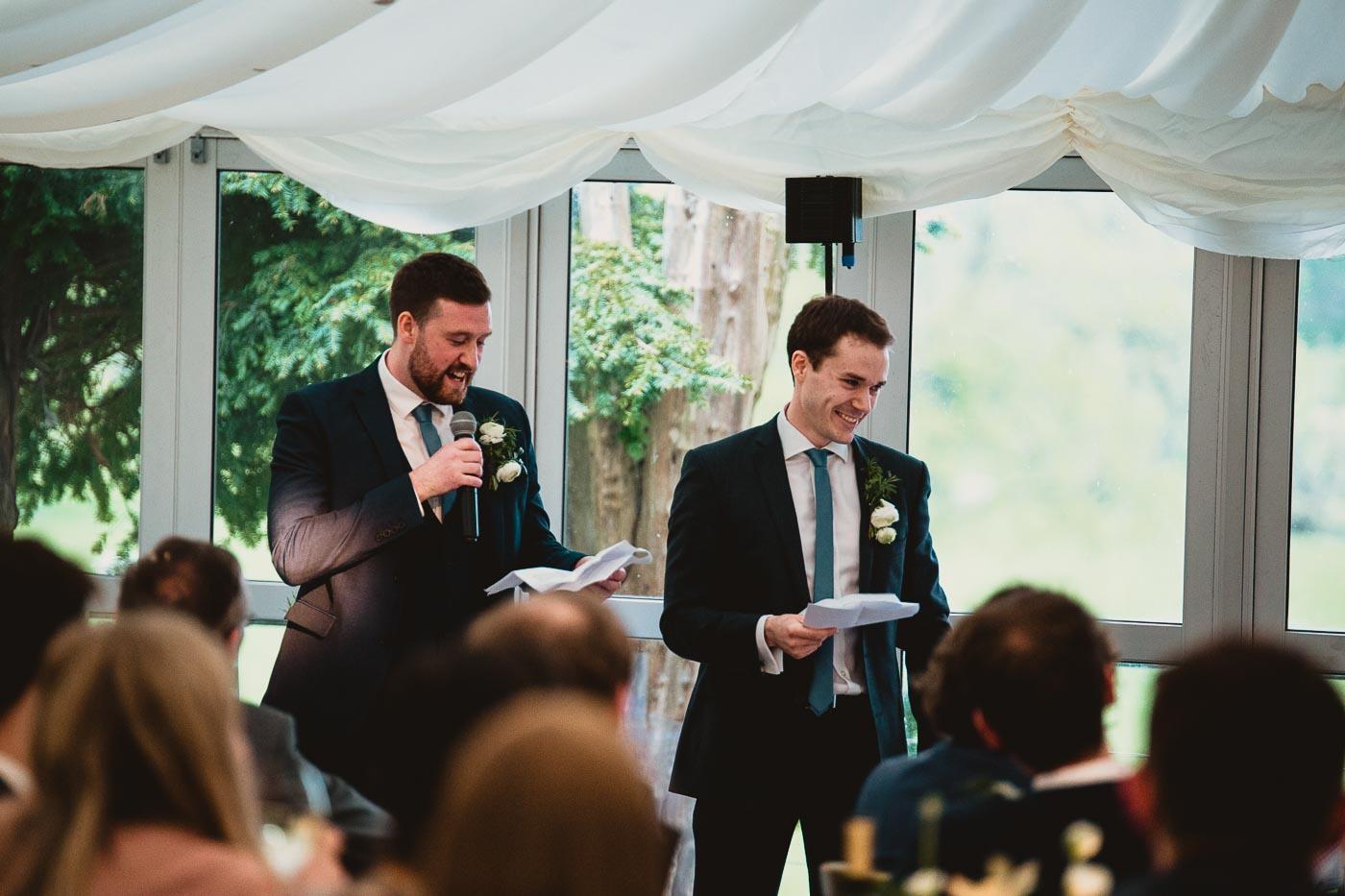 Two best men giving speeches