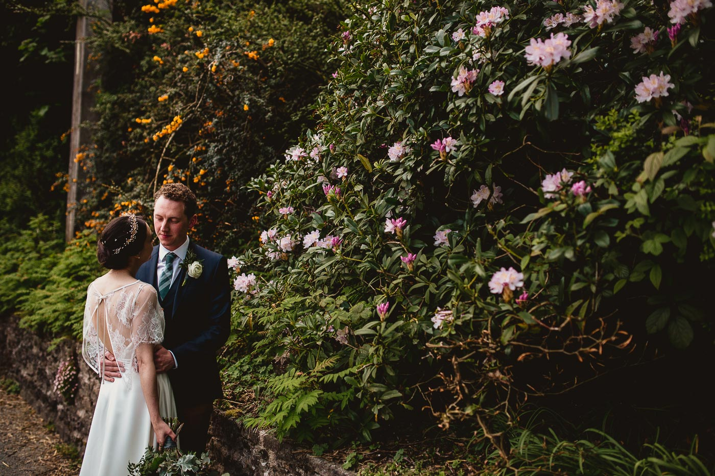 Couple portrait with greenery in background, The Inn at Whitewell wedding photography