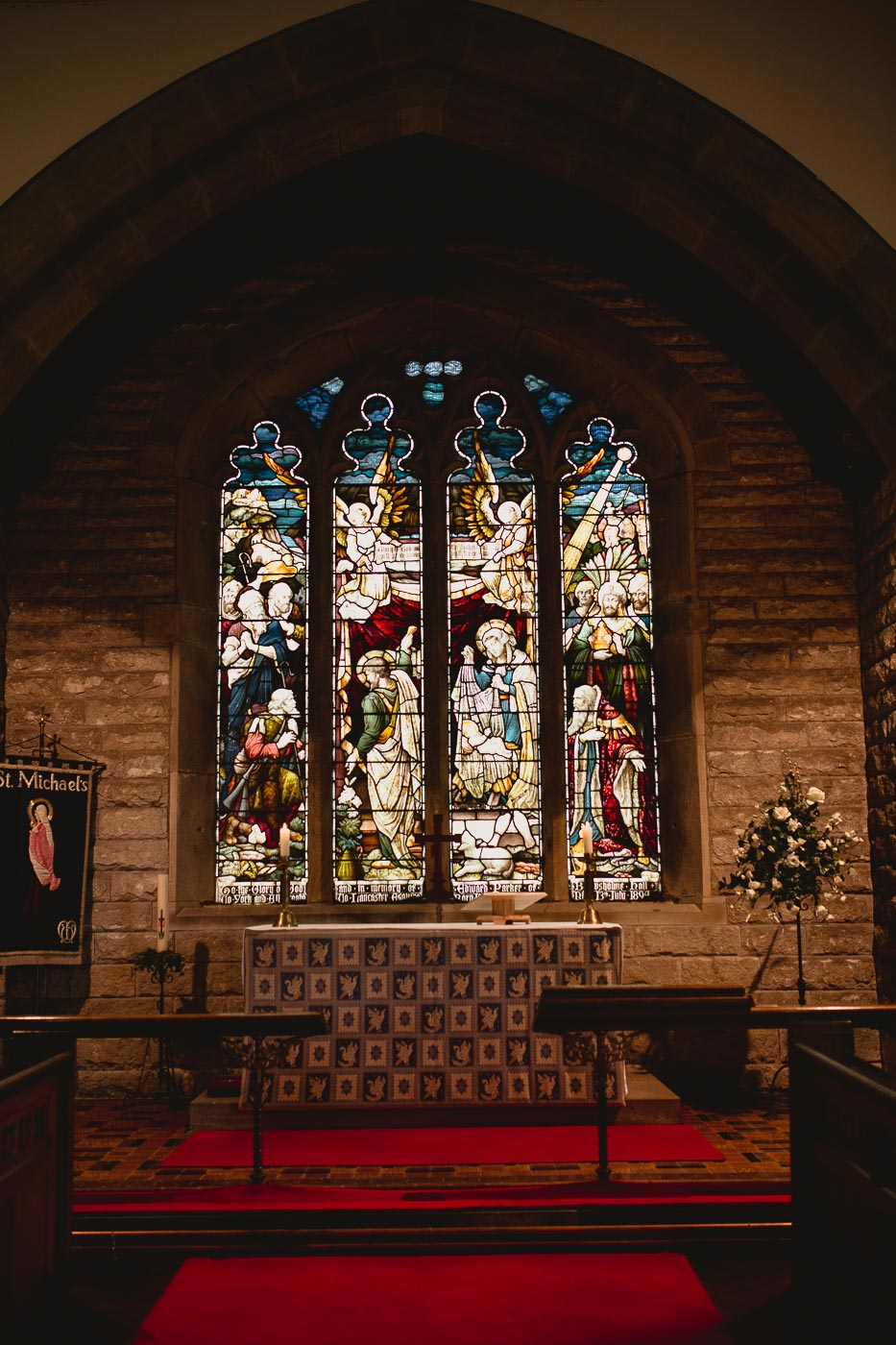 St Michaels church stain glass window from the inside, A rustic church wedding in Lancashire