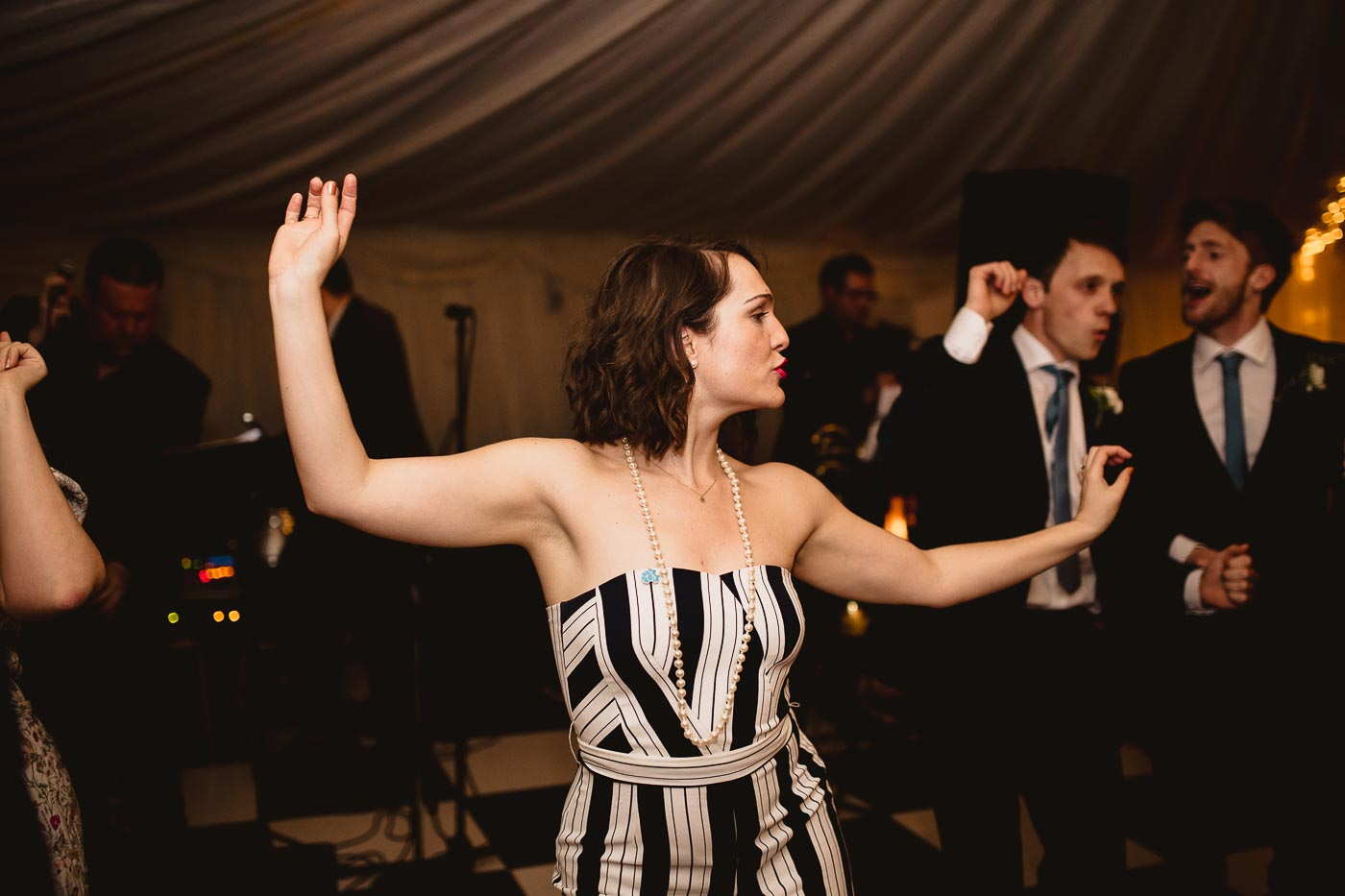 energetic wedding guest dancing