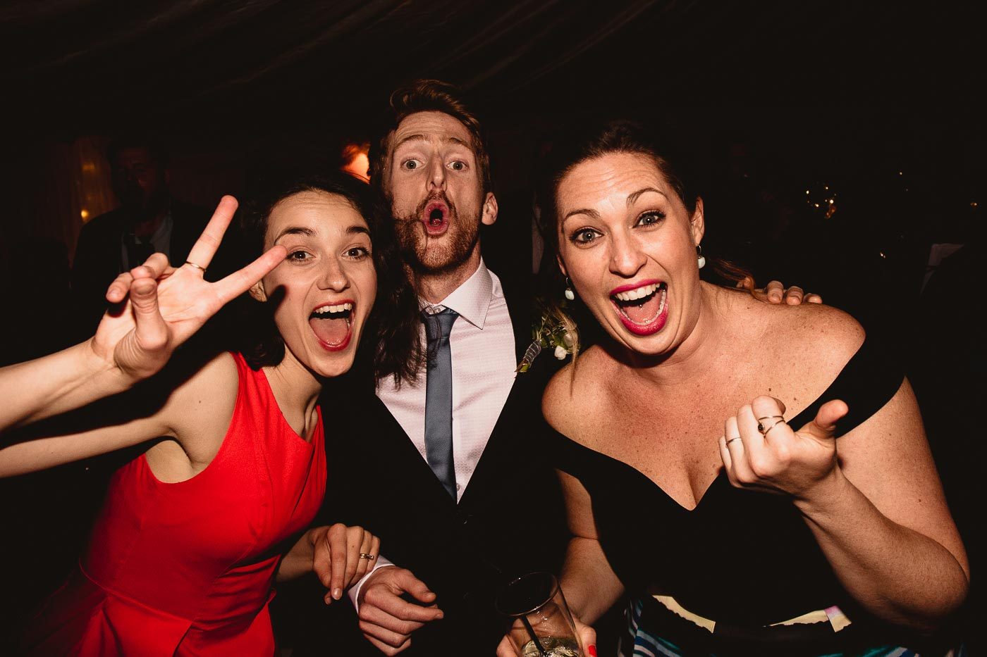 guests being silly at evening reception