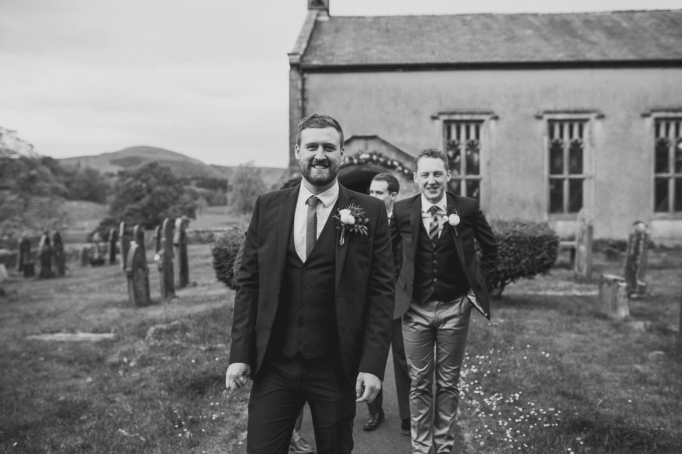 groomsmen walking to the church, Documentary Photographer