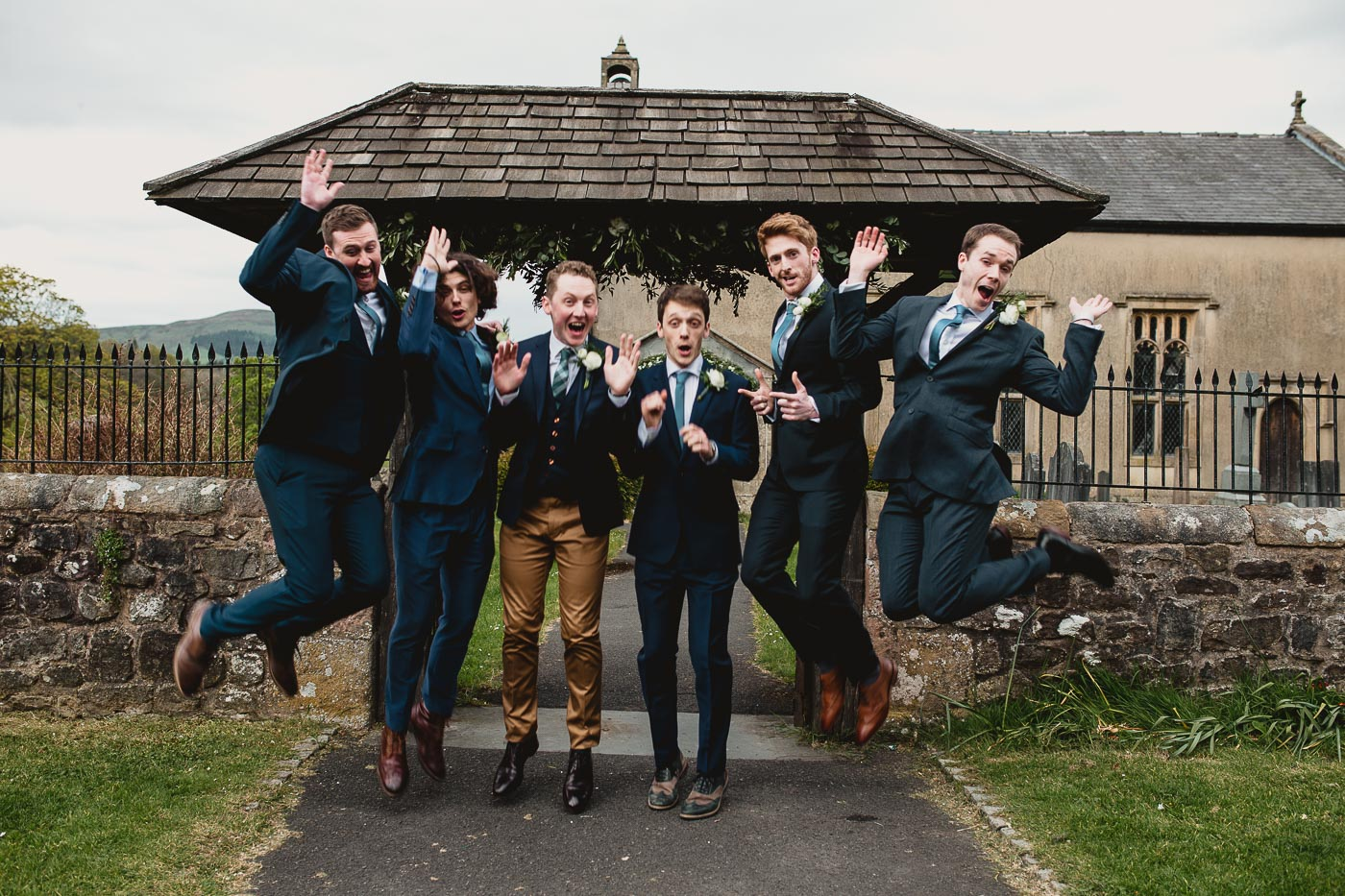 groomsmen jumping in front of the church, A stylish wedding in the ribble valley