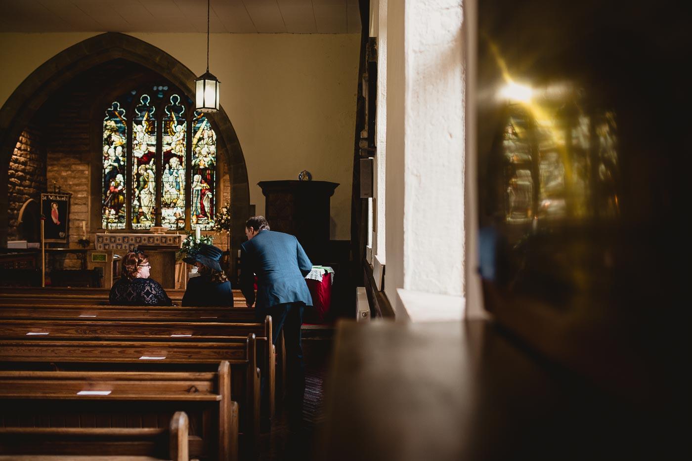wedding guests sitting down in the church, A summer church wedding