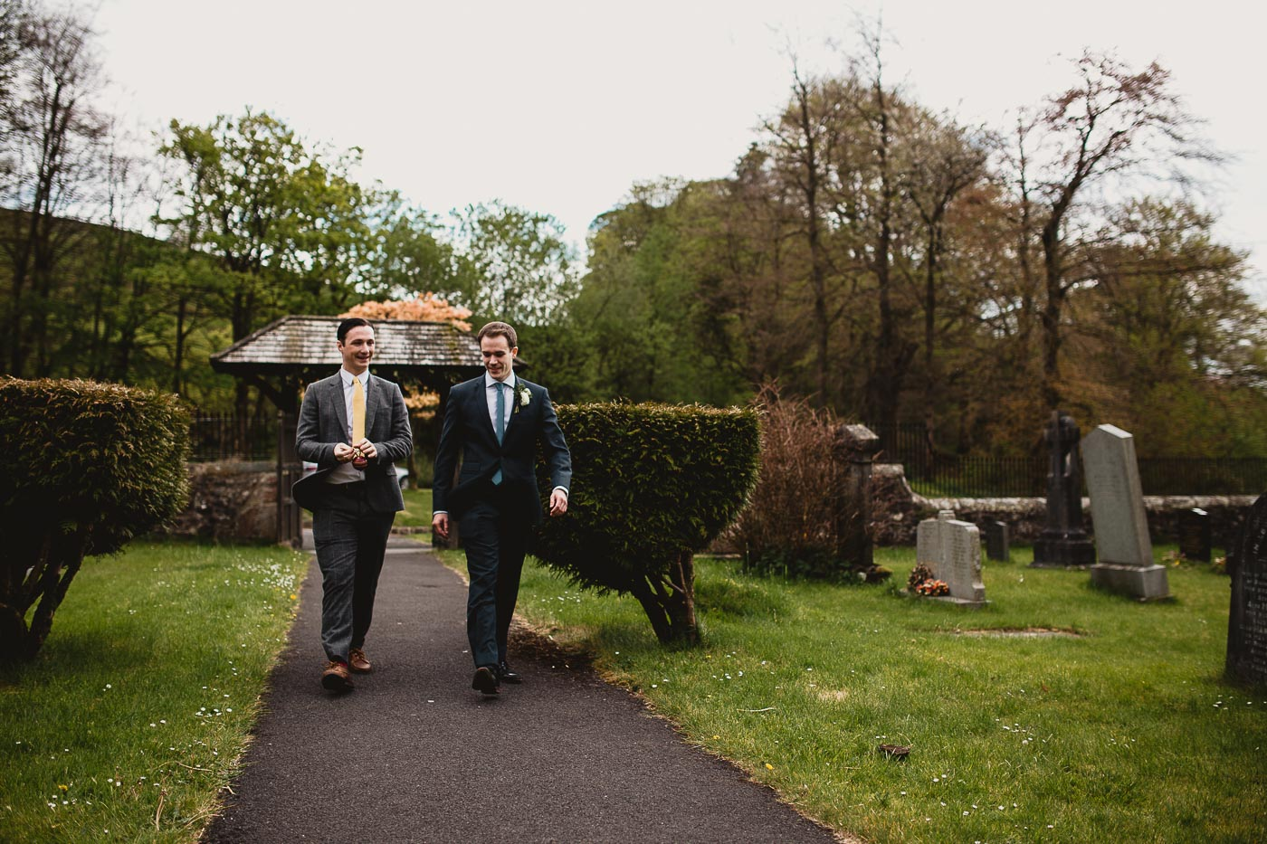 Wedding guests walking along the path to the church from the Inn at Whitewell, Lancashire Wedding Photographer