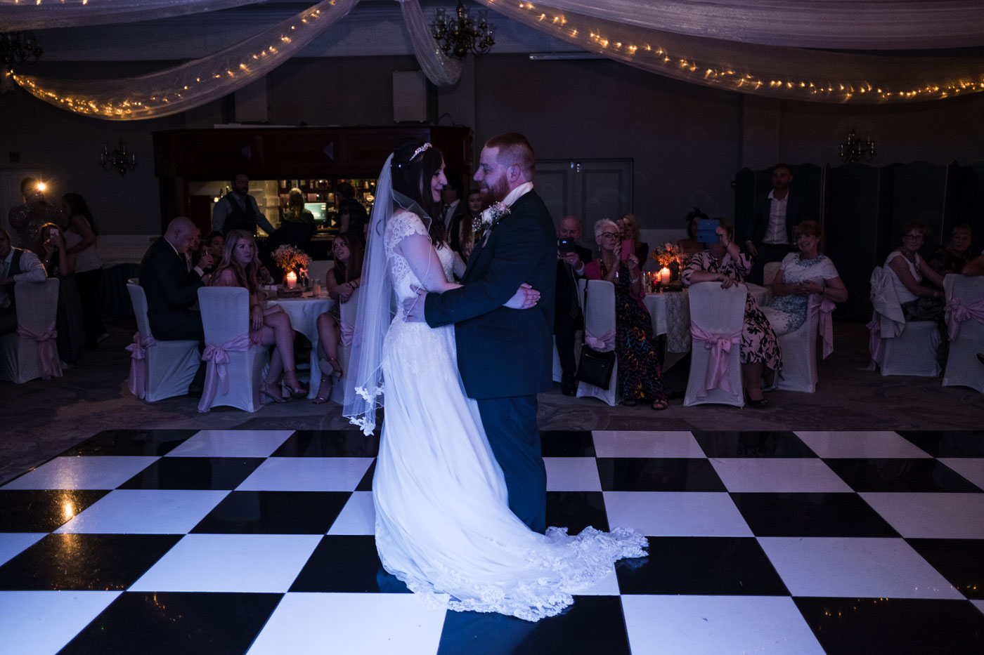 bride and groom about to do the first dance, cheshire wedding photography