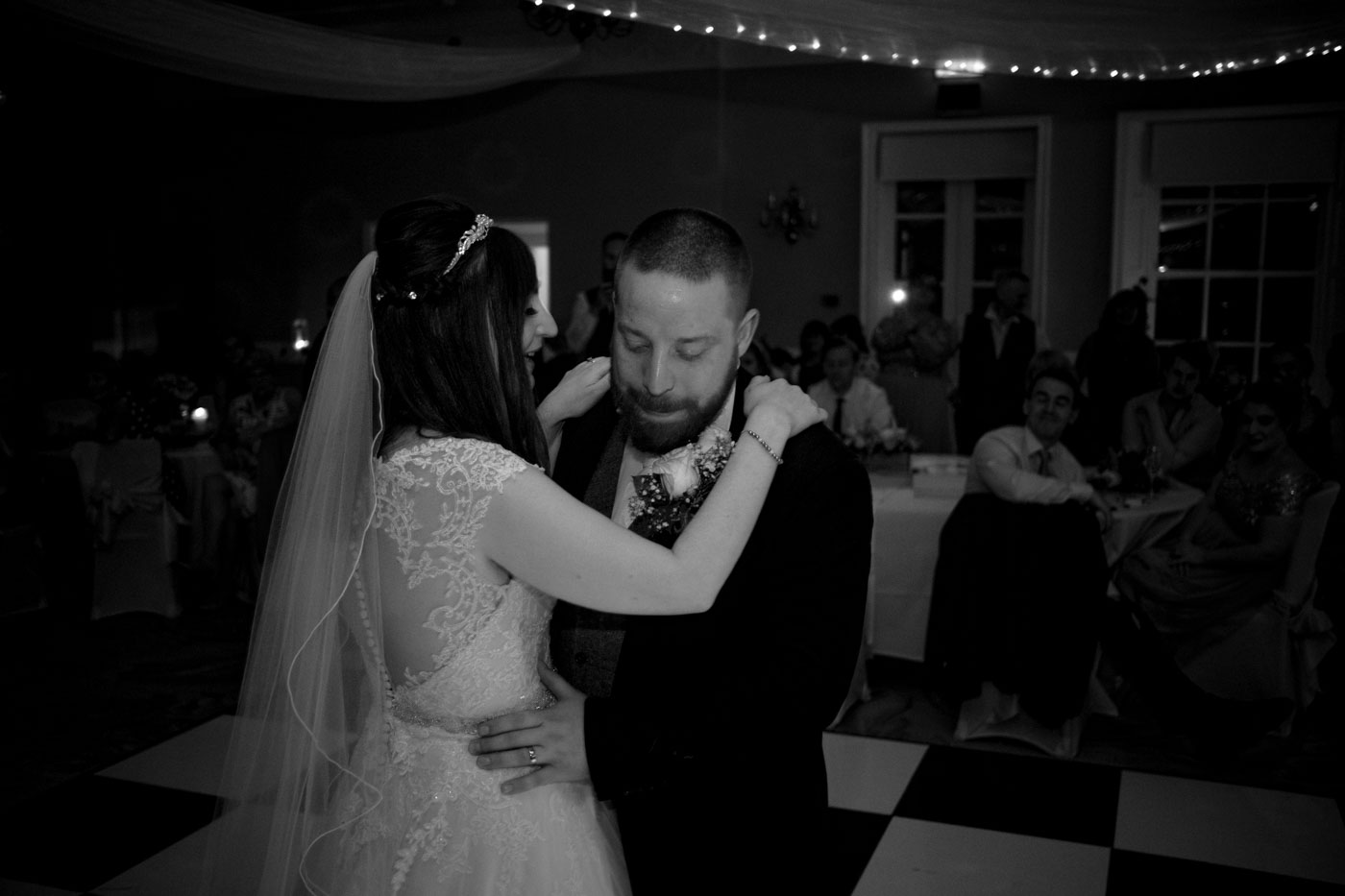 intimate first dance with guests watching in the background