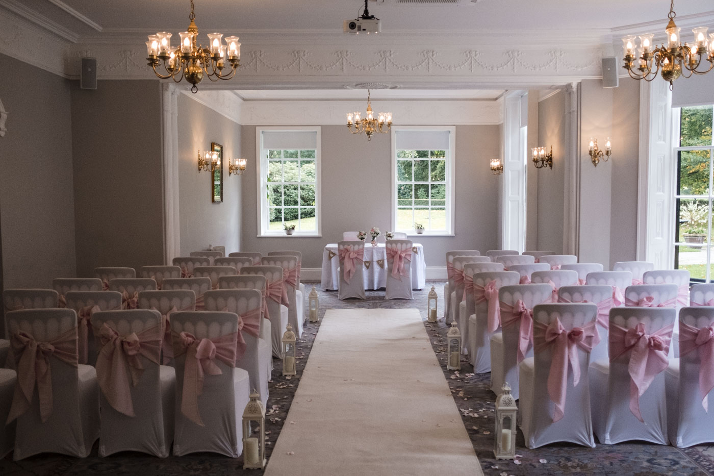 ceremony venue dressing with candles and pink theme
