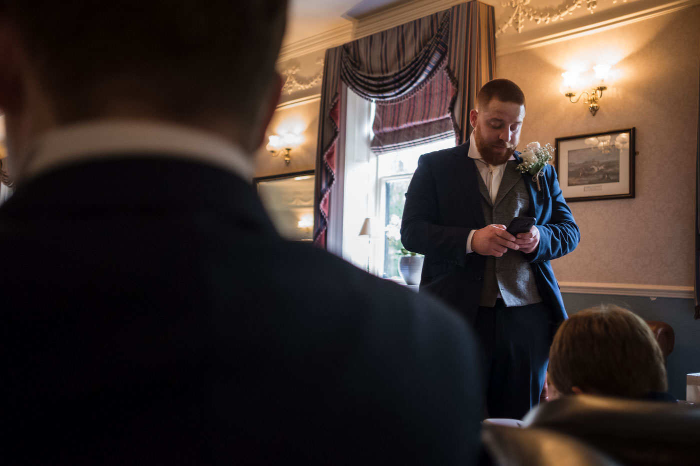 groom checking his phone