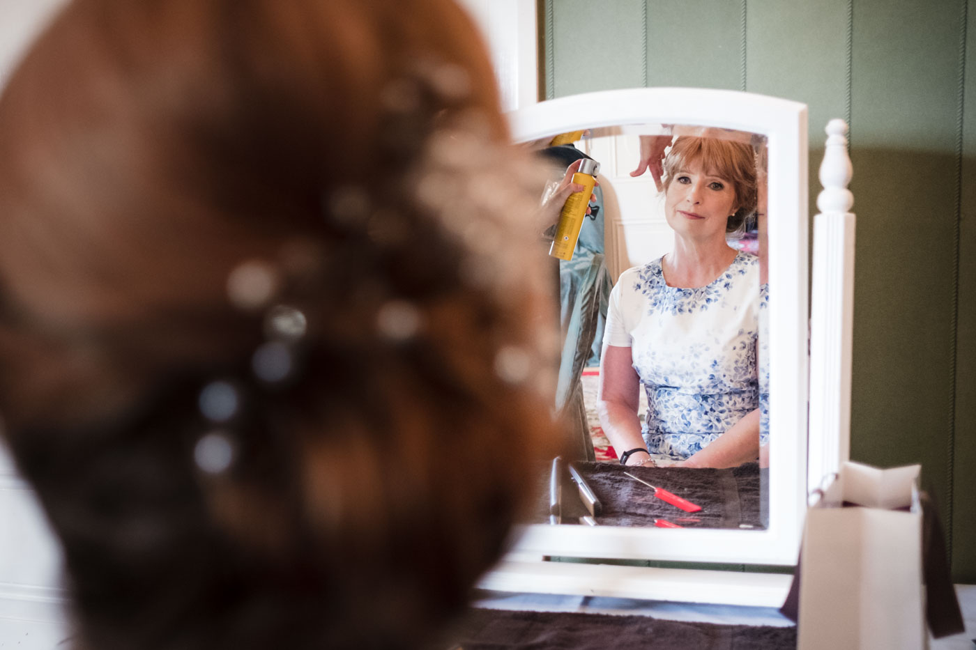 mother of the bride reflection in a mirror