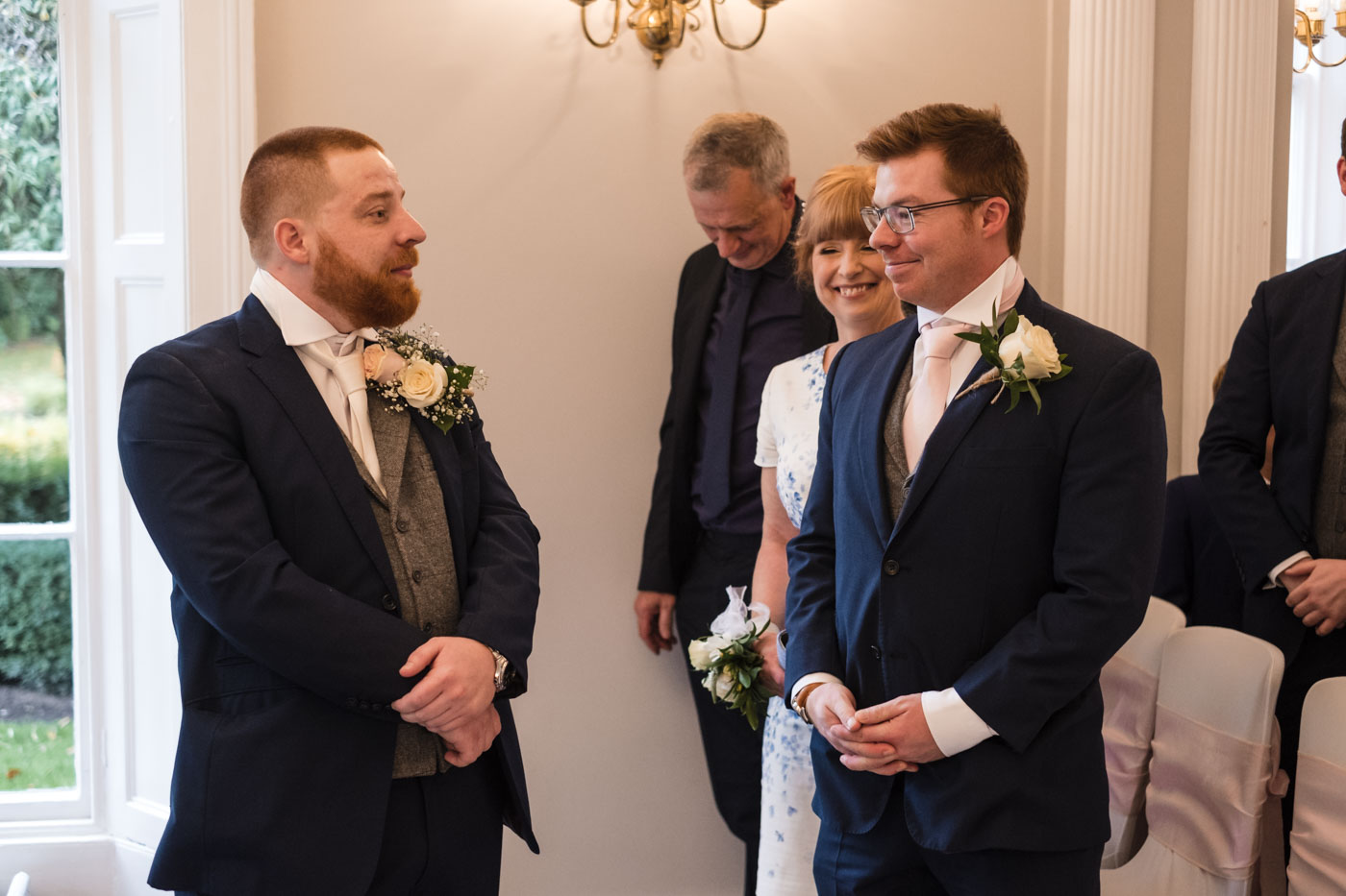 groom and best man stood waiting for the bridal party